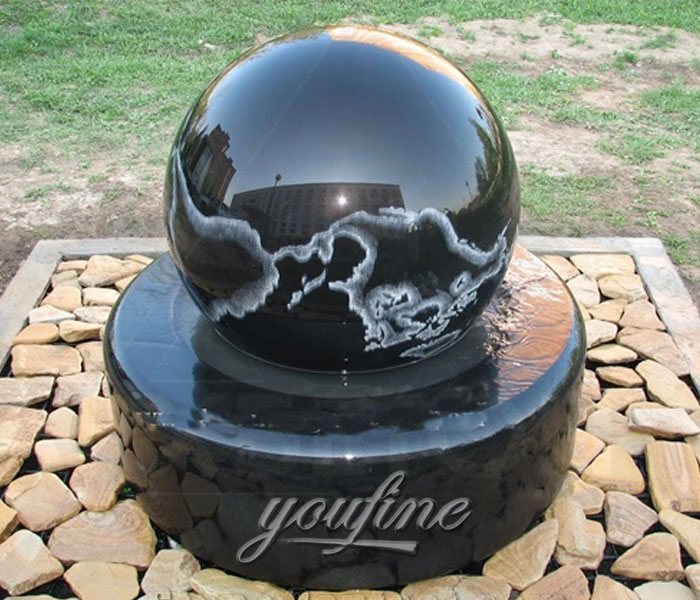 Outdoor park casting black granite stone fengshui ball with wold map fountains for sale
